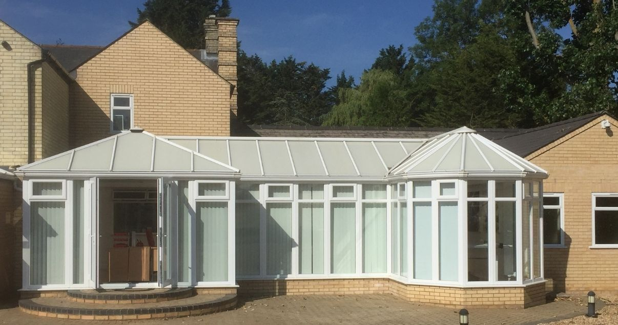 a conservatory with a polycarbonate roof may cause leaks and does not fare well with rough weather