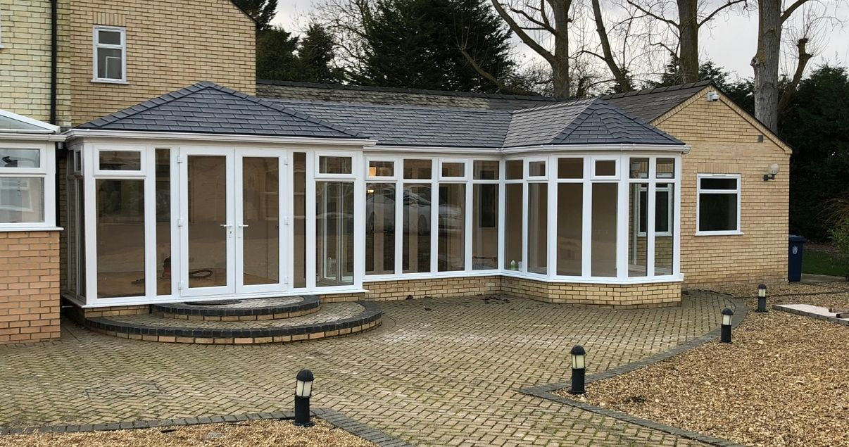conservatory transformation with a modern roof that provides great insulation