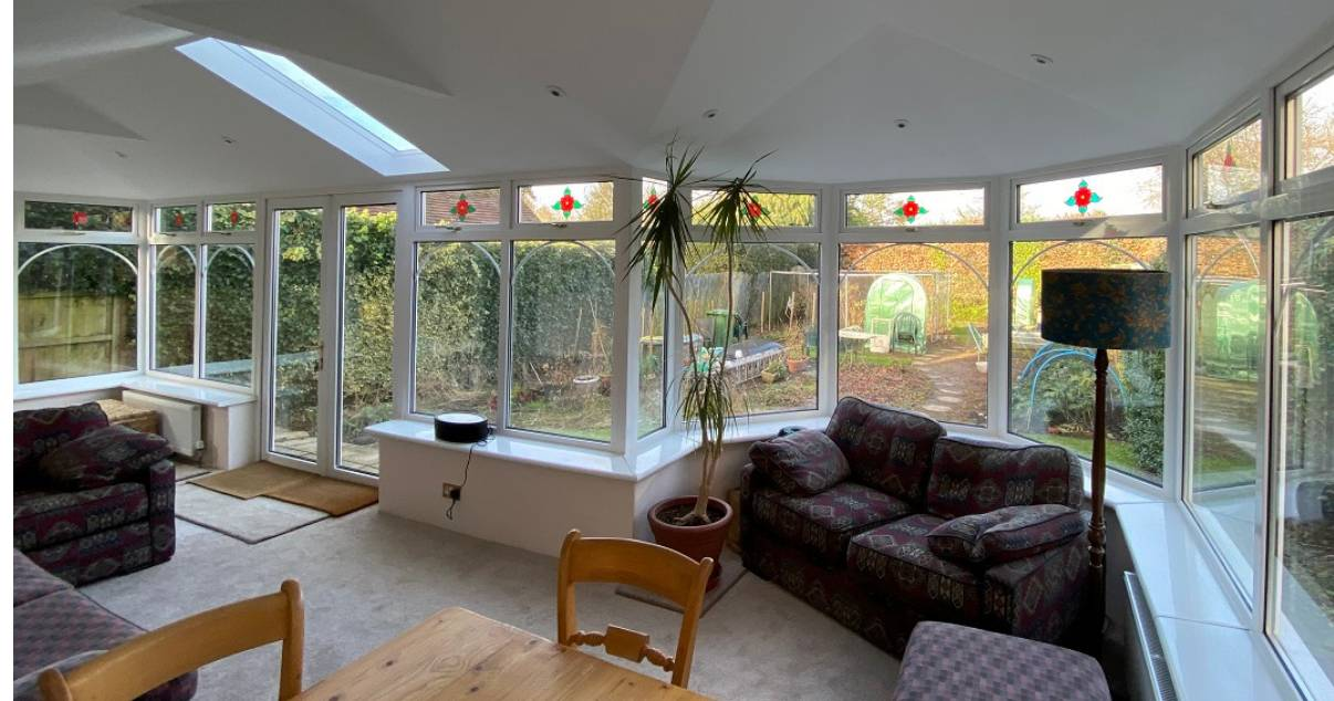 comfortable dinning and living area after warm conservatory transformation